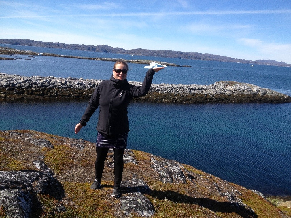 A PhD student from UEF at the backyard of the university campus in Nuuk, Greenland.