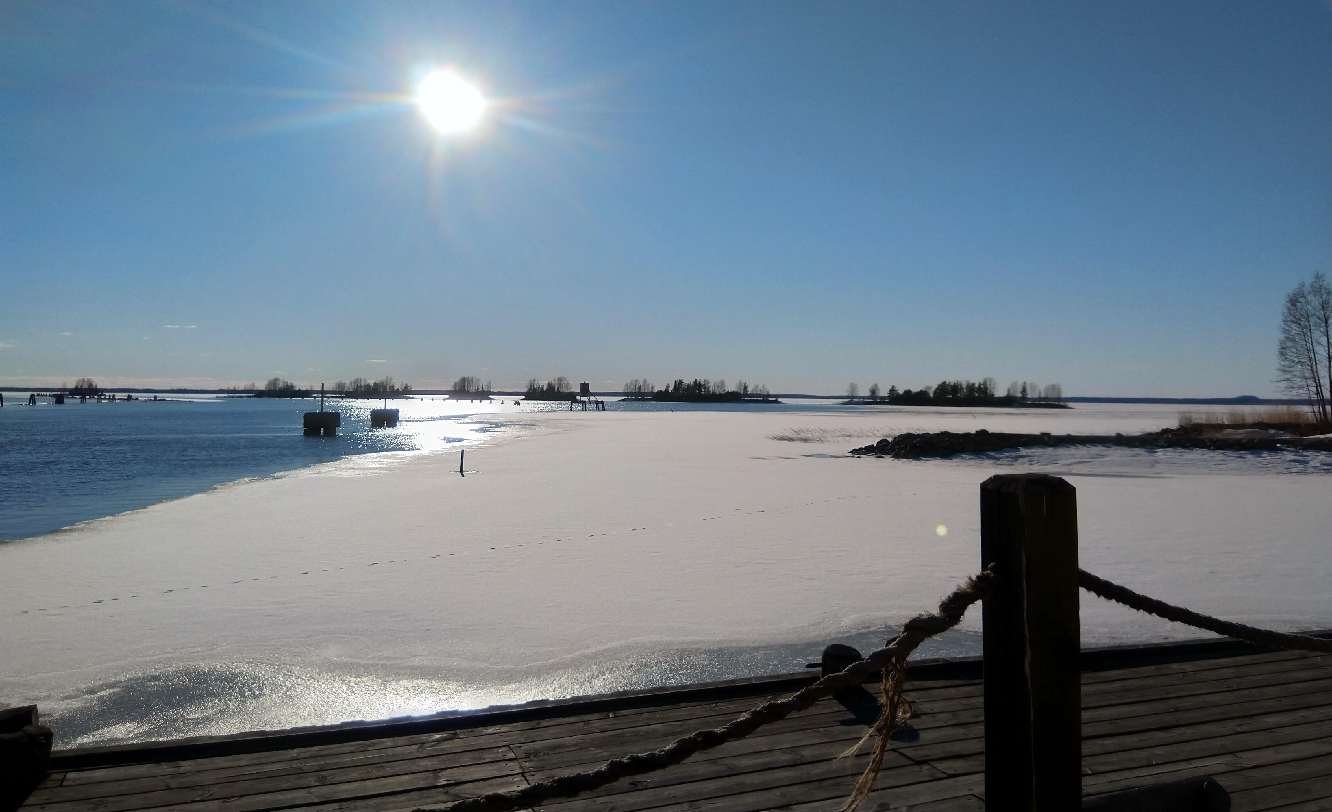Landscape with a half-frozen river.