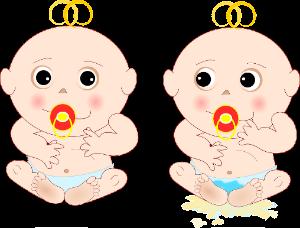 Kaksi vauvaa, joilla on tutti suussa
