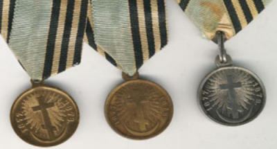 Old medals with emblems of orthodox cross and crescent moon.