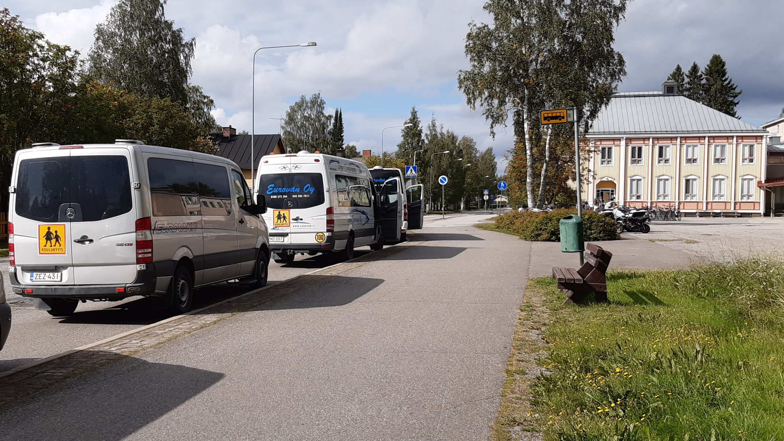 School buses in front of a school in the centre of Lieksa